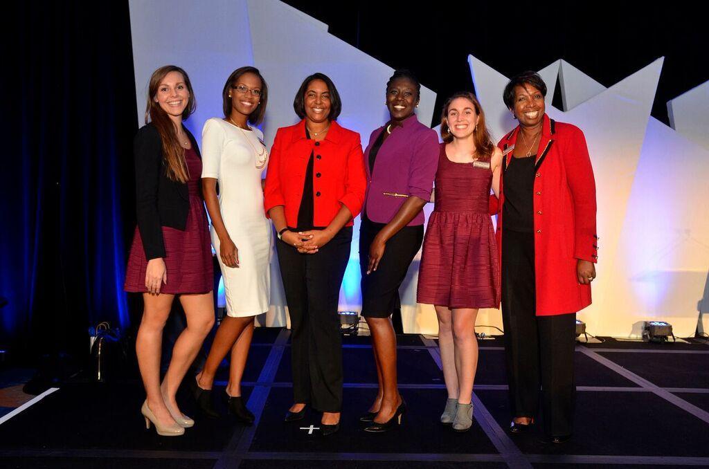 Sandy D. Welfare, Women in Technology Executive Director (third left) with her team